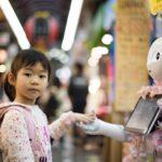 a kid and humanoid robot